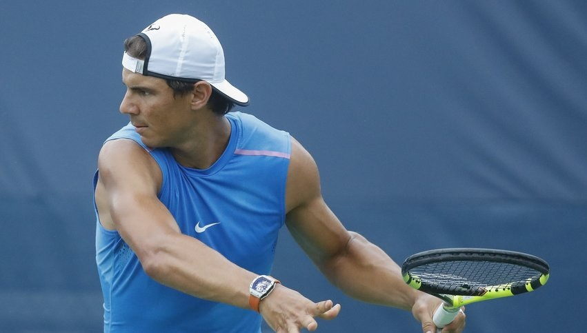 Rafael Nadal covering hair with hat